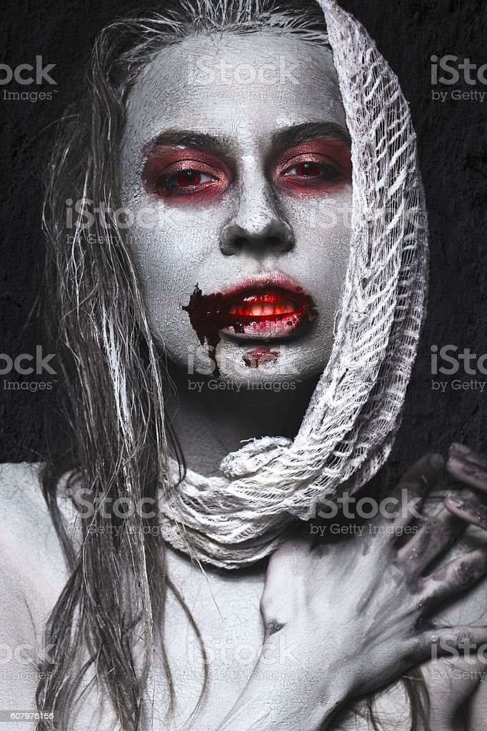 Girl in form of zombies, Halloween corpse with blood on stock photo
