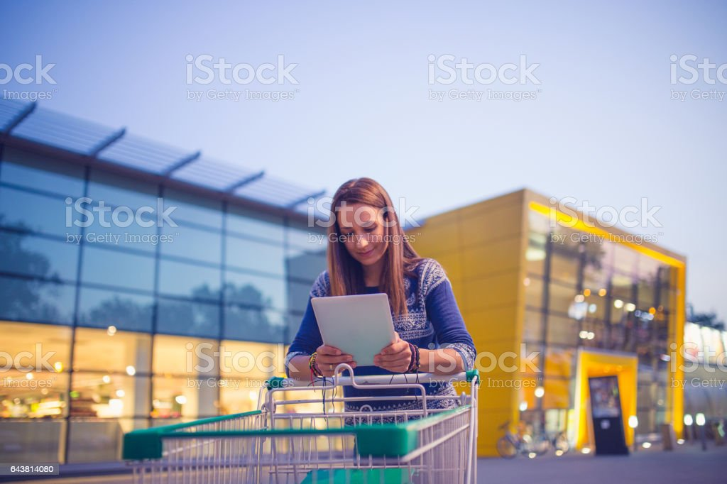 Girl in front of big store stock photo