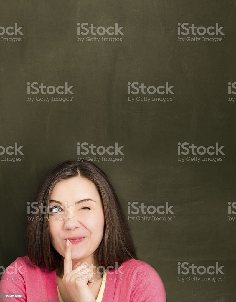Girl in front of empty blackboard. royalty-free stock photo