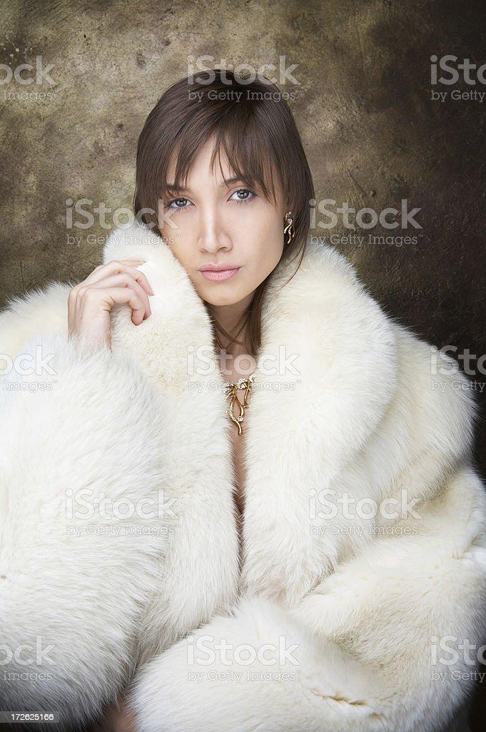 Girl in fur coat royalty-free stock photo