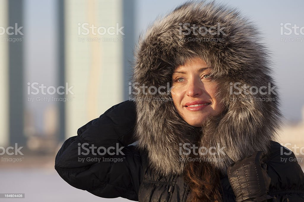 girl in fur hat at winter stock photo