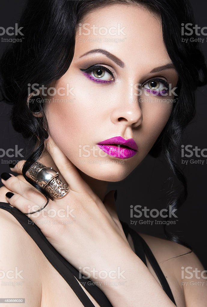 Girl in Gothic style with leather accessories and bright makeup. stock photo