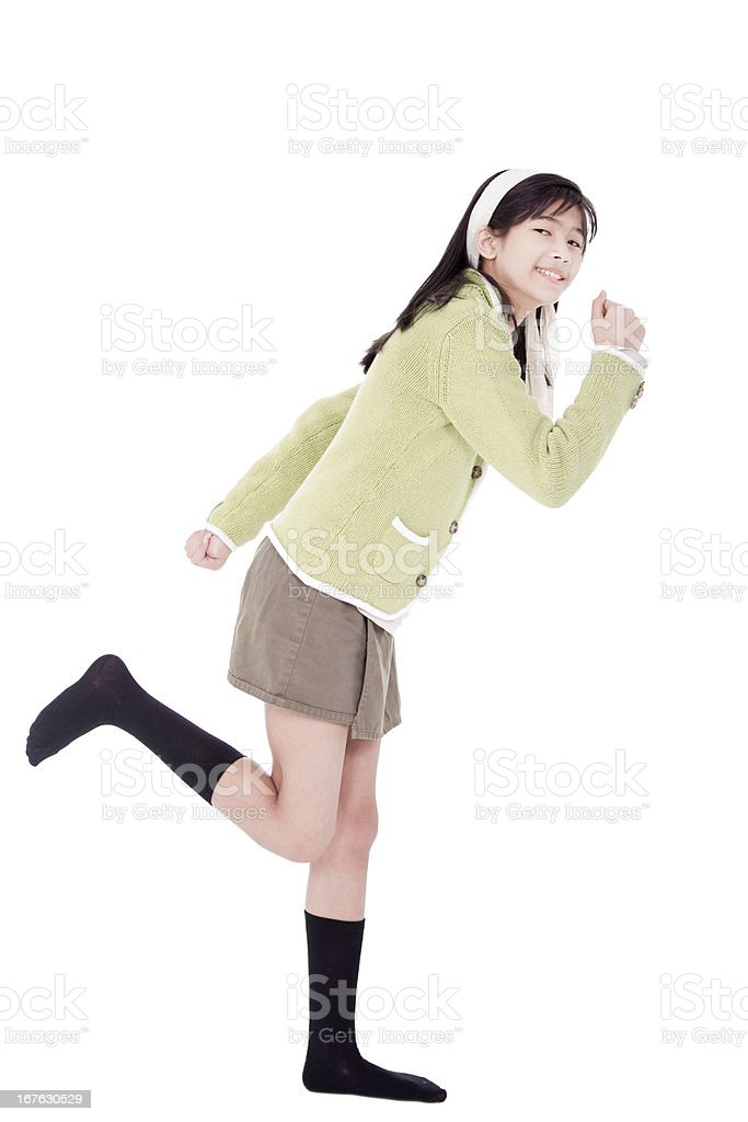 Girl in green sweater and skort, running position, isolated stock photo