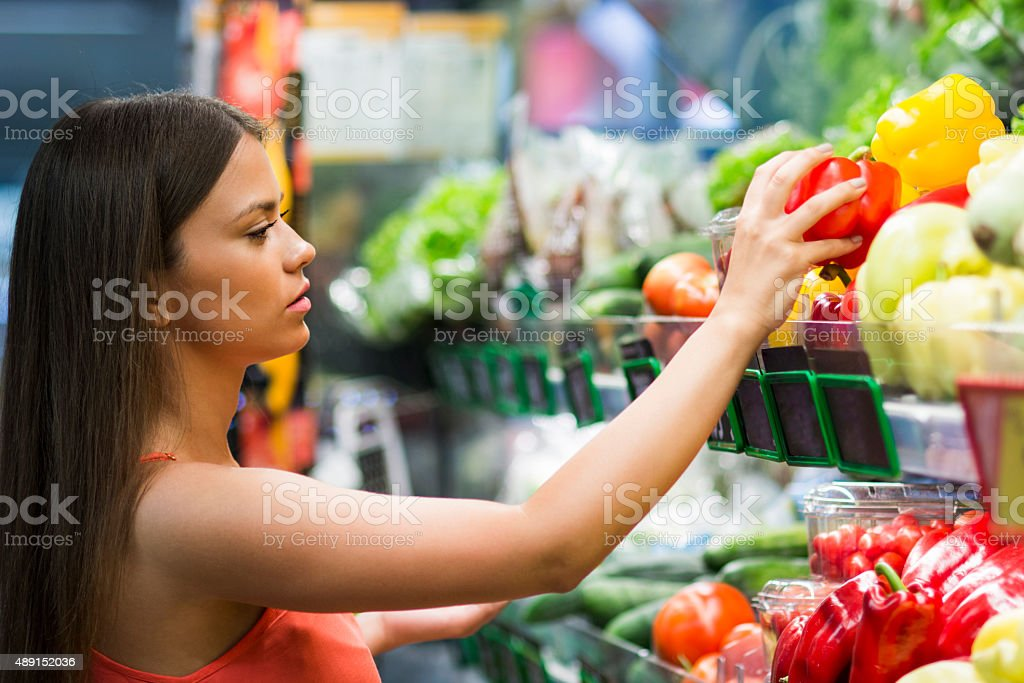 Girl in grocery store stock photo
