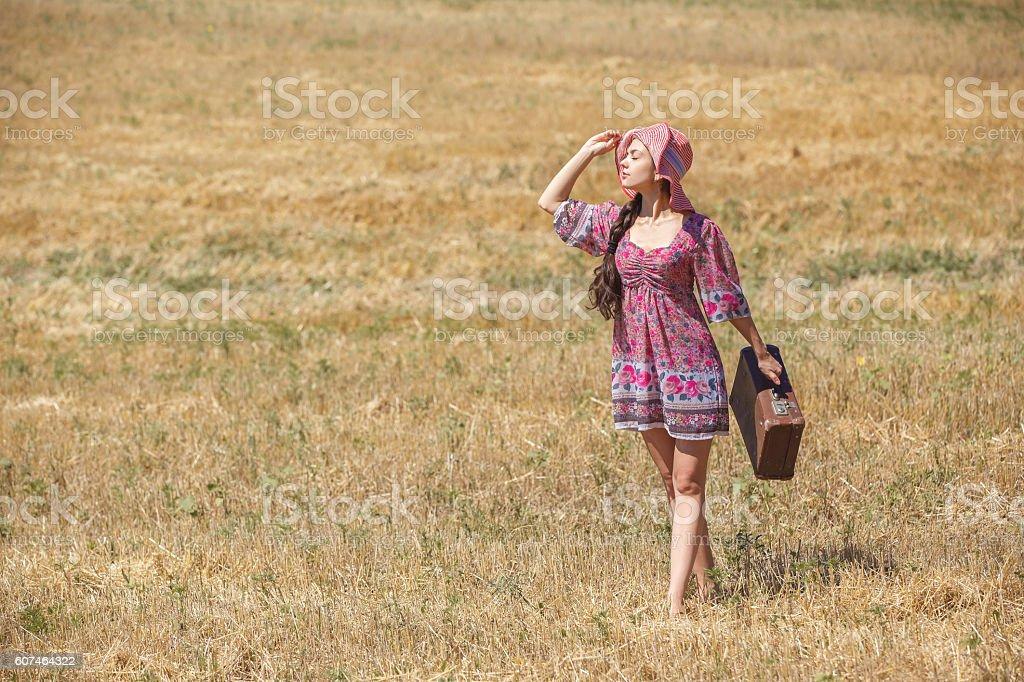 girl in hat on wheat field stock photo