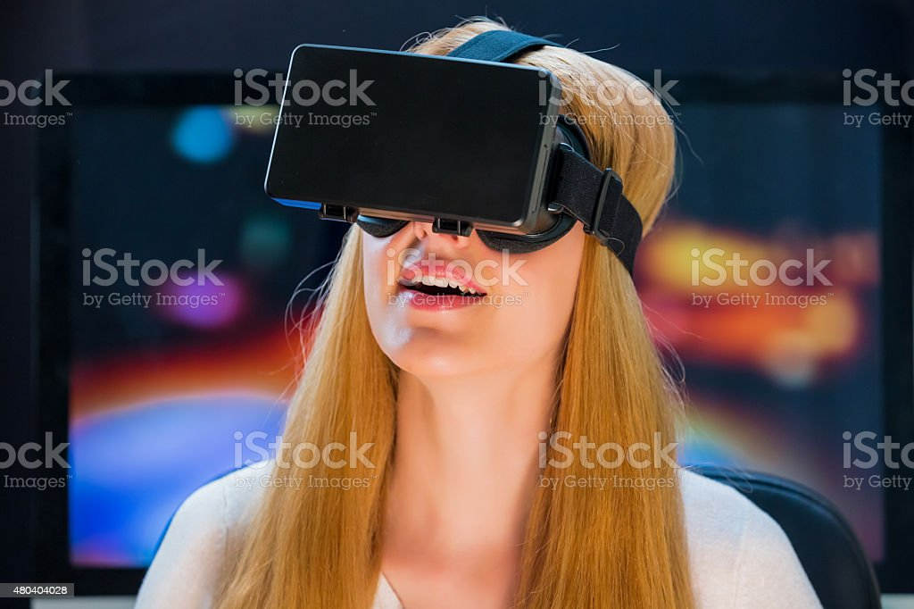 Girl in head-mounted display stock photo