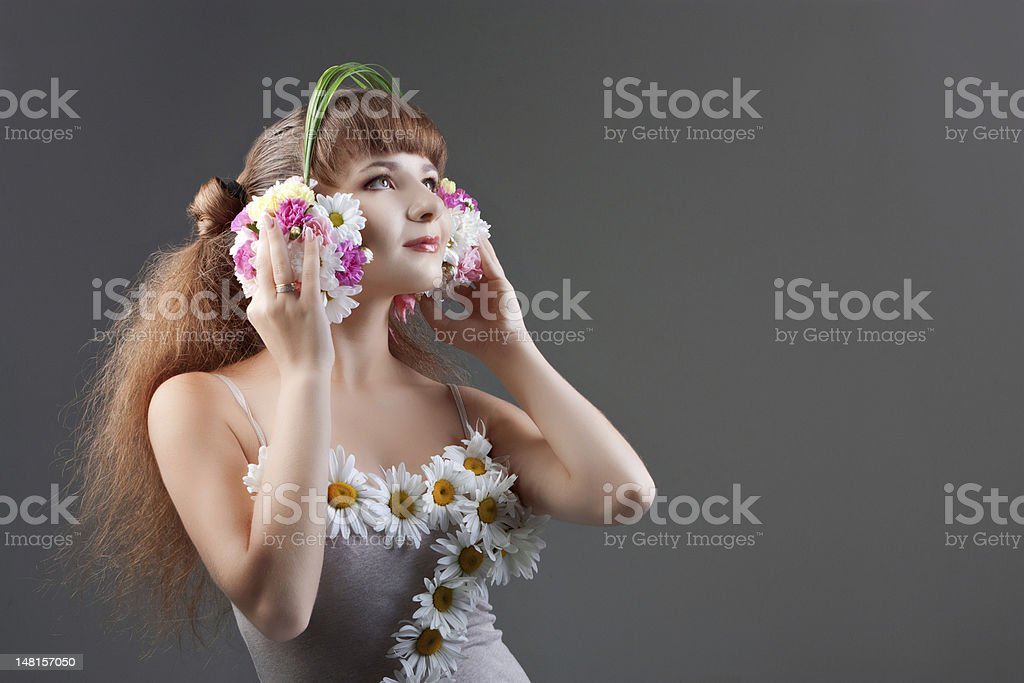 girl in headphones of flowers royalty-free stock photo
