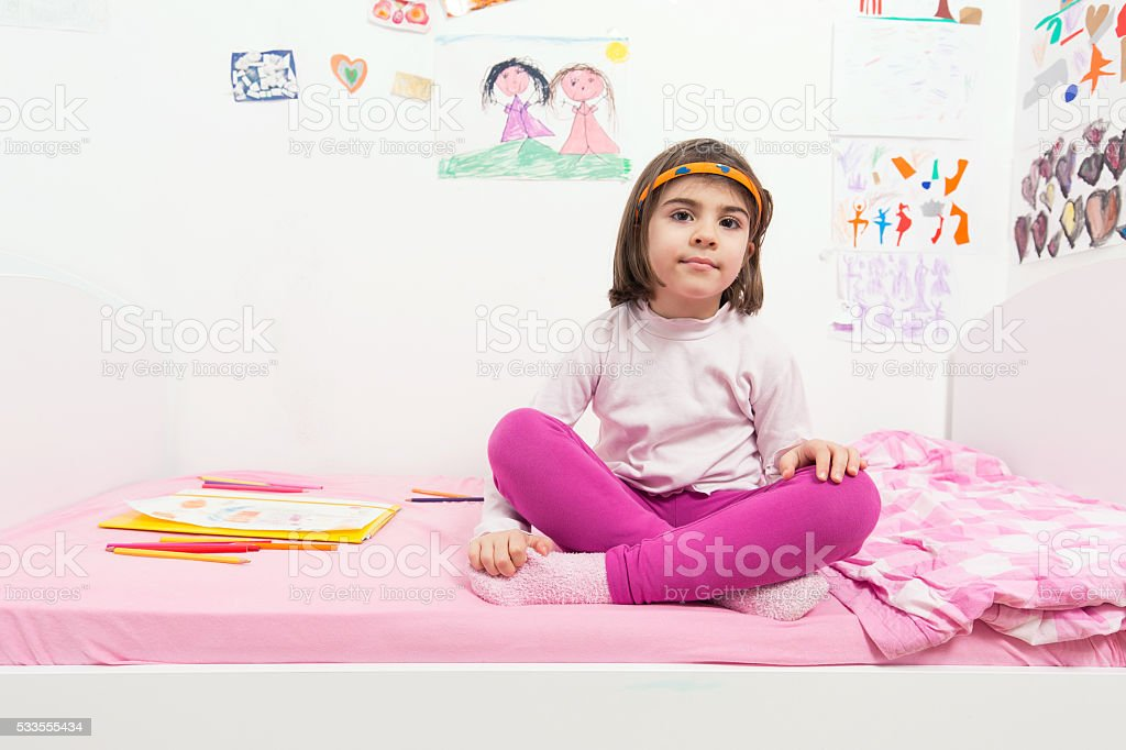 Girl in her room stock photo