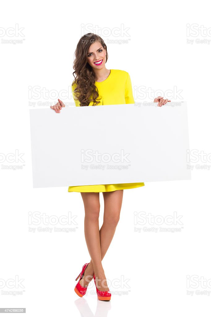 Girl In High Heels Holding Copy Space stock photo