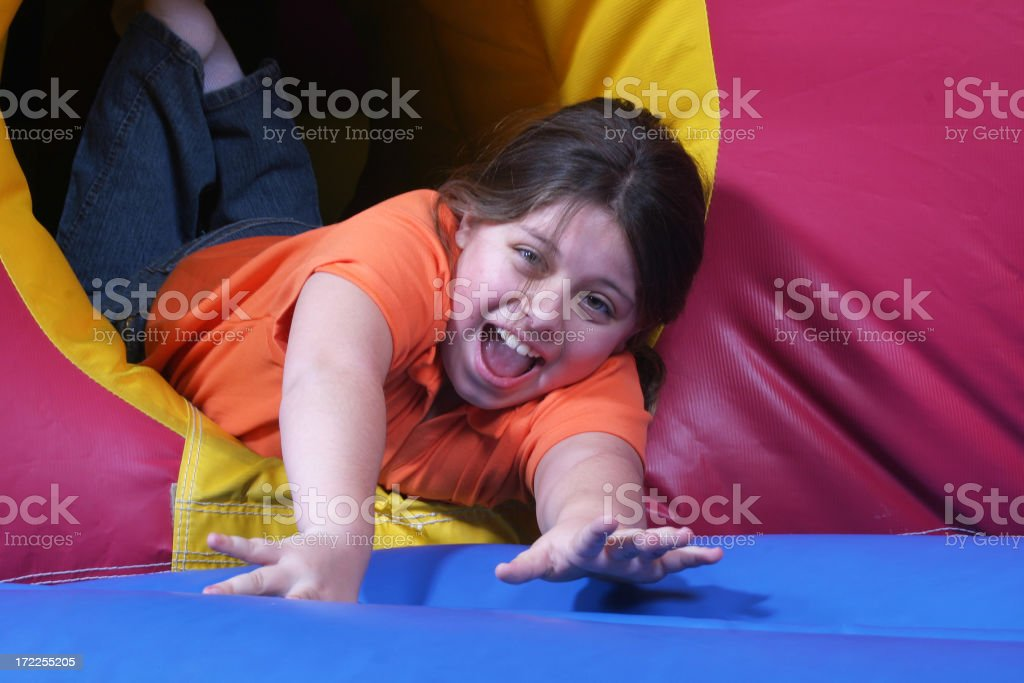 Girl in inflatable jumper royalty-free stock photo