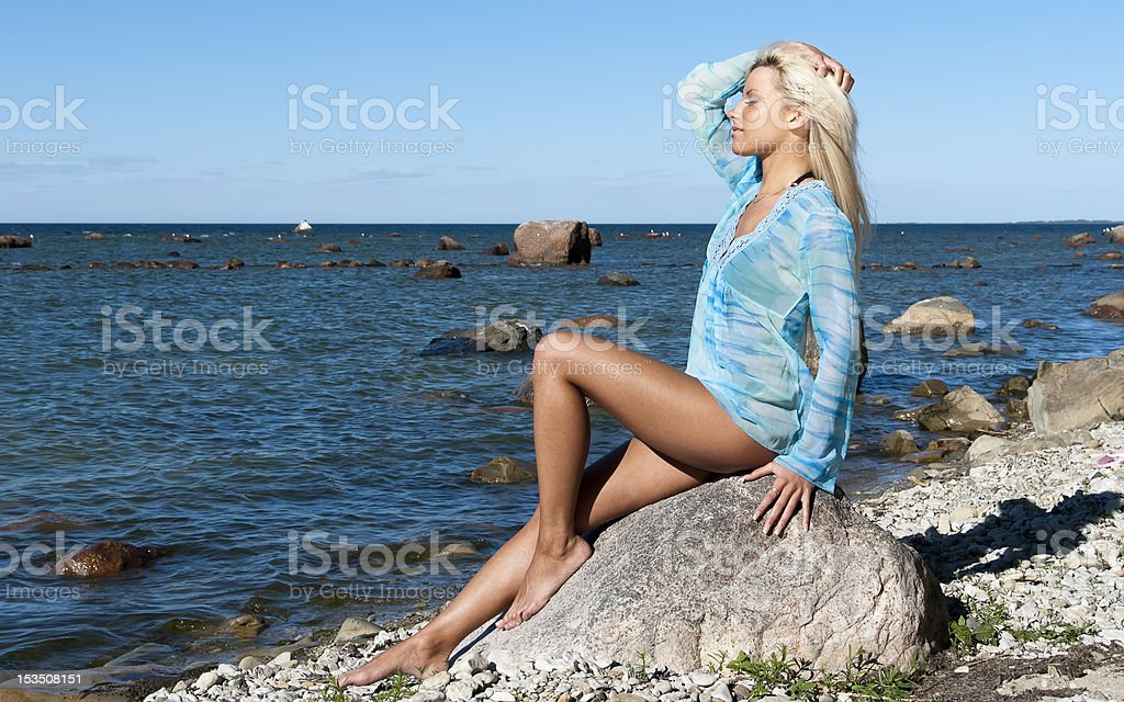 girl in is enjoying summer on the beach stock photo