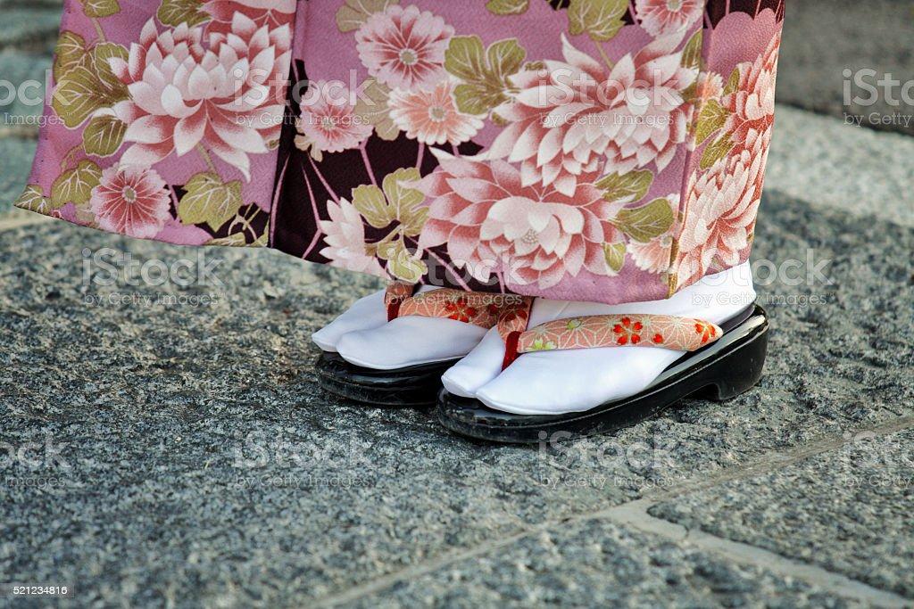 Girl in Japanese kimono and zori sandal stock photo