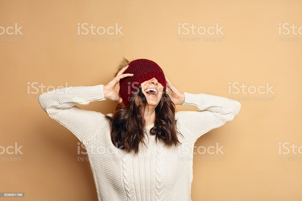 Girl in Knitted Sweater and Beanie Hat stock photo