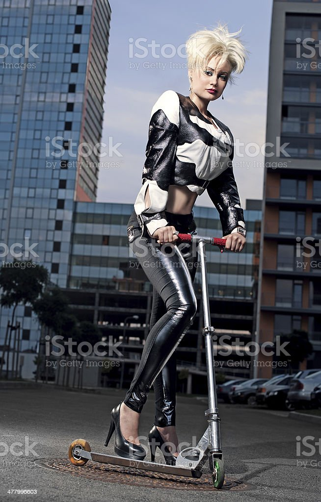 Girl in leather jacket on scooter stock photo