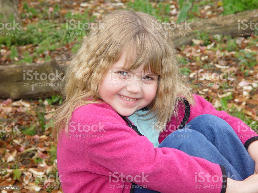 Girl in leaves royalty-free stock photo