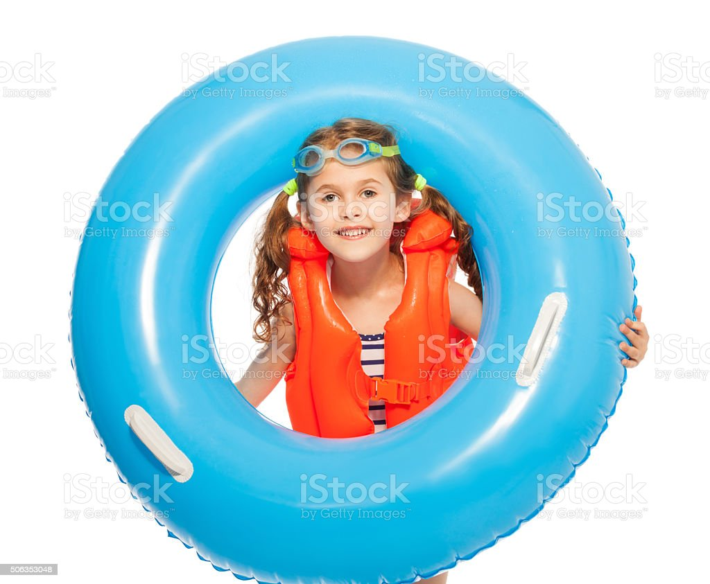 Girl in lifejacket and goggles with rubber ring stock photo
