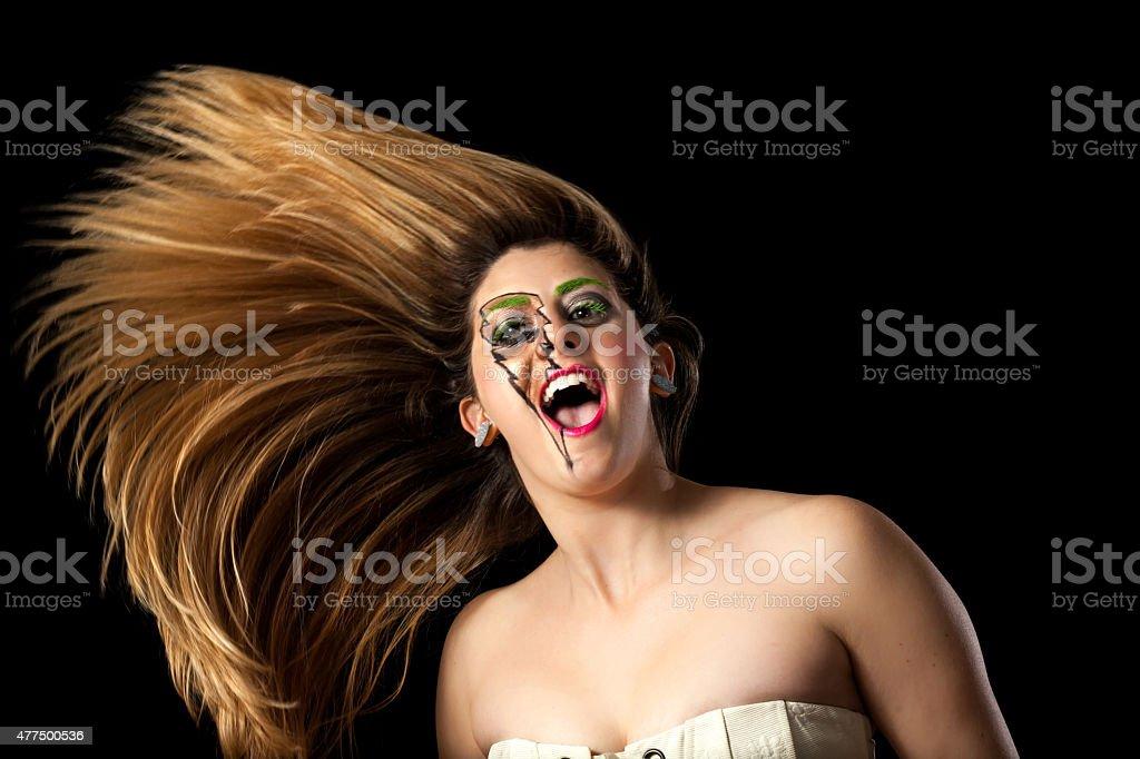 Girl In Lighting Makeup Crazy Hair stock photo