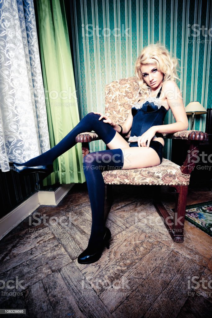 Girl in Lingerie Sitting on Chair royalty-free stock photo