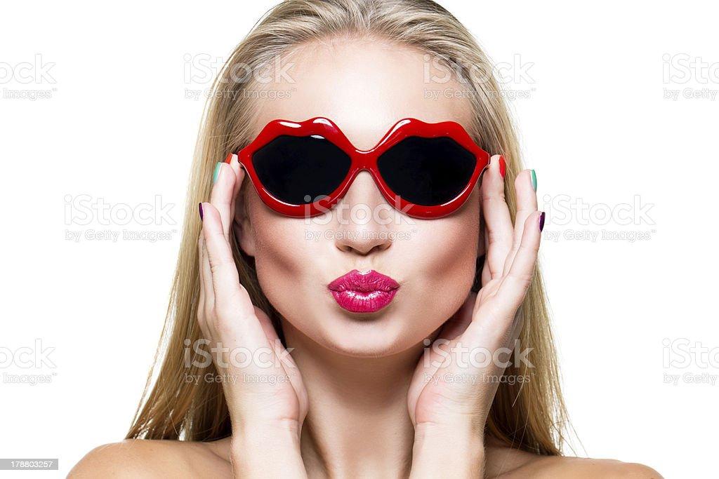 Girl in lips shaped sunglasses stock photo
