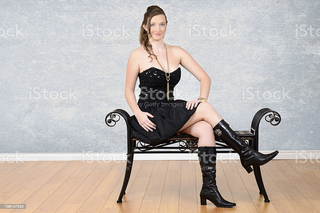Girl in little black dress with boots royalty-free stock photo