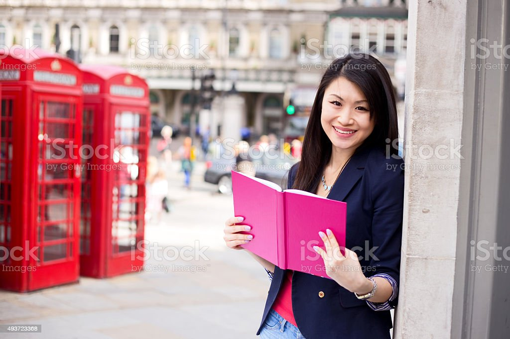 girl in London with a book royalty-free stock photo