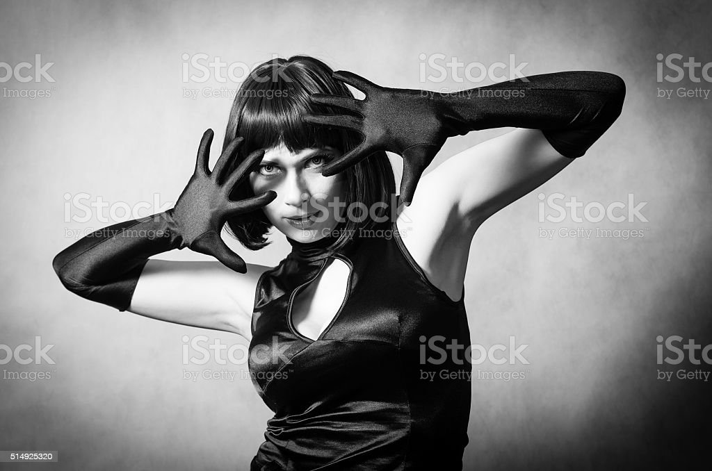 Girl in long gloves with raised hands stock photo