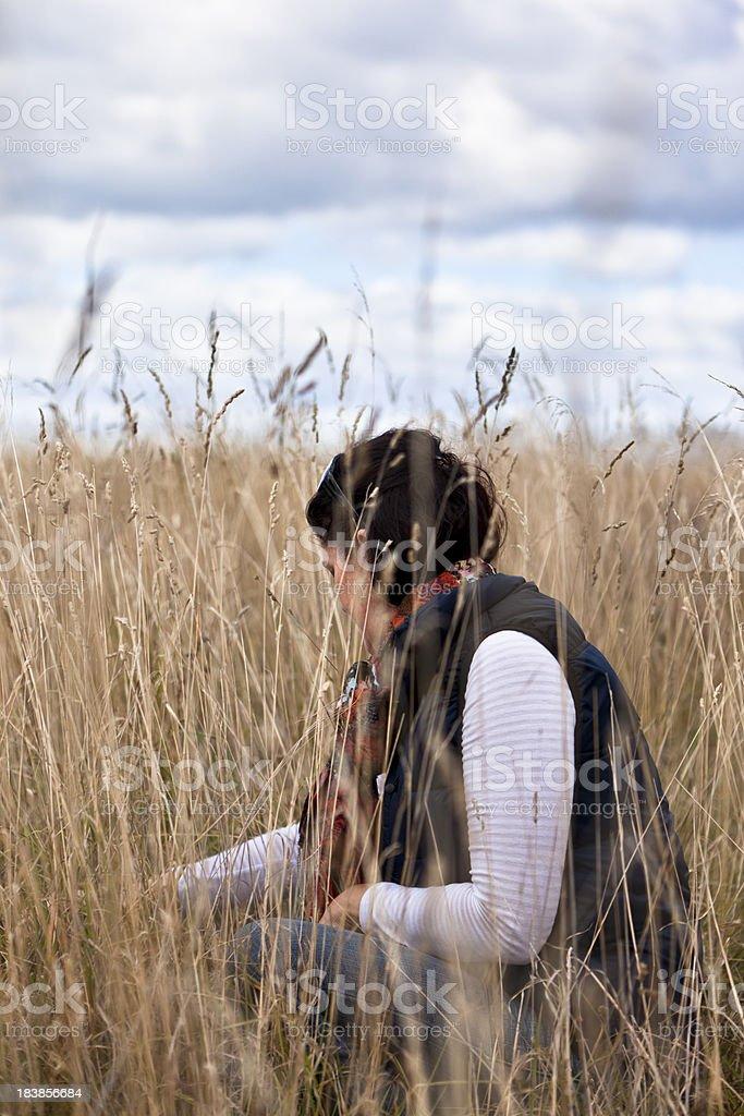 girl in long grass stock photo