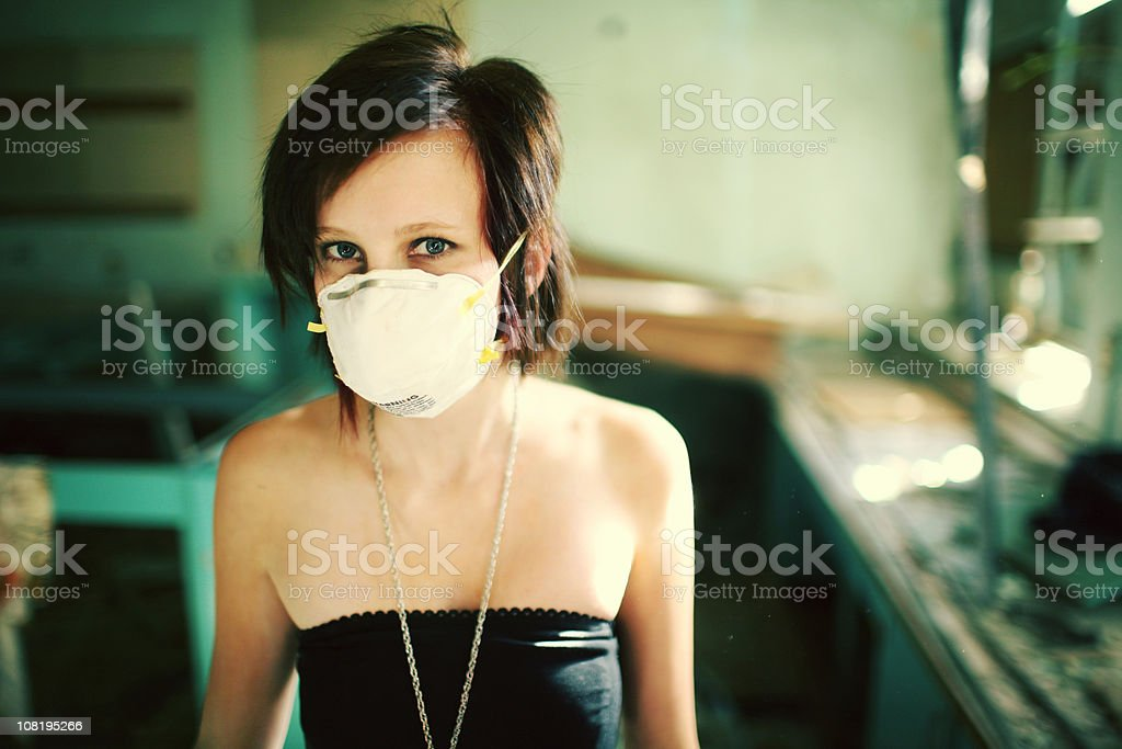 girl in mask looking at camera royalty-free stock photo
