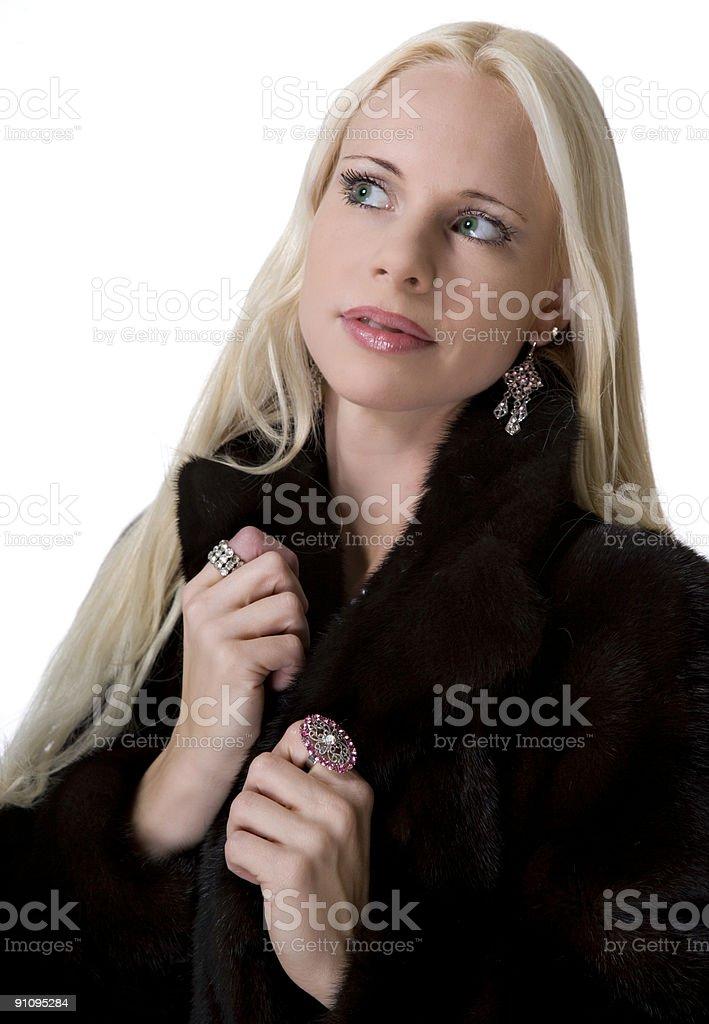 Girl in mink coat stock photo