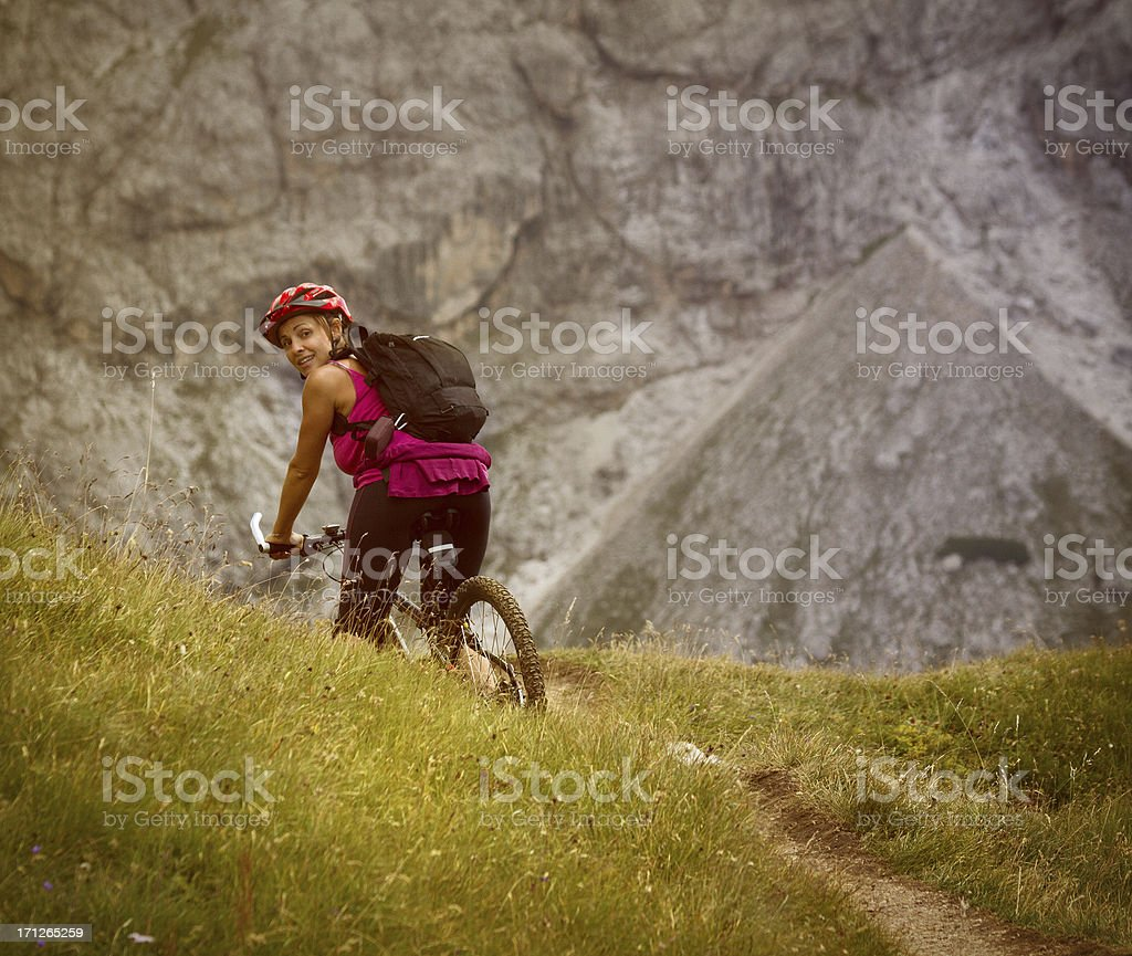 Girl in Mountain Bike on Italian Dolomites stock photo
