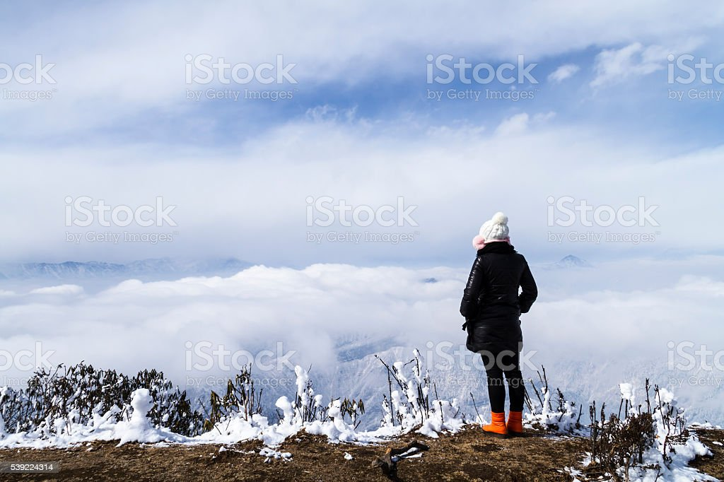 Girl in Mountain Niubeishan Looking at View stock photo