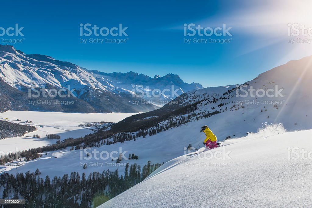 girl in off-piste skiing stock photo