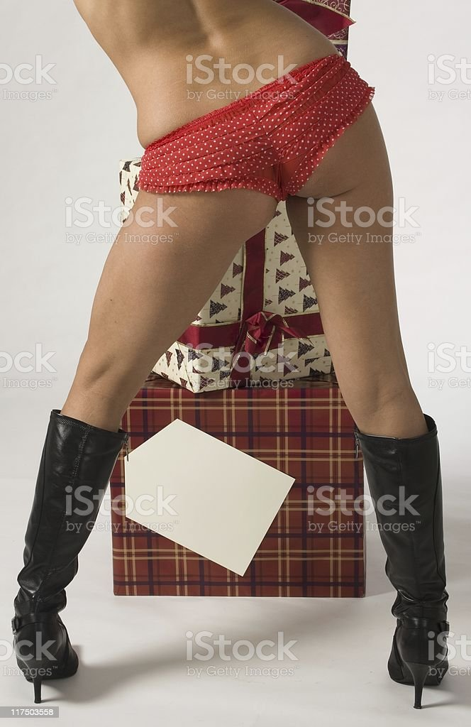 Girl in panties with Christmas gifts royalty-free stock photo