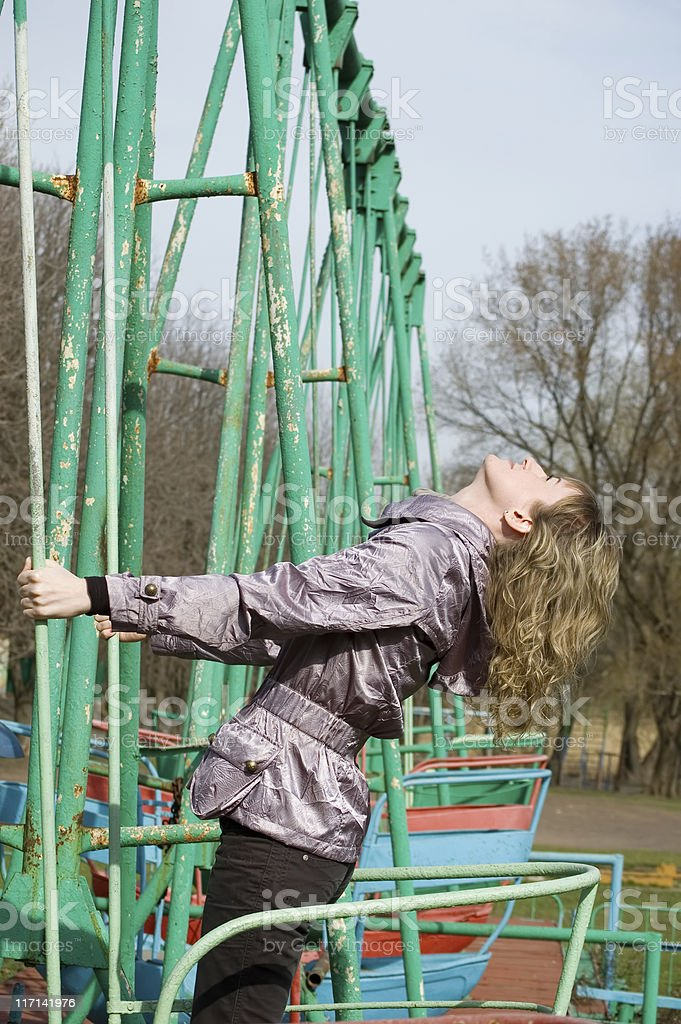 Girl in park on old swing stock photo