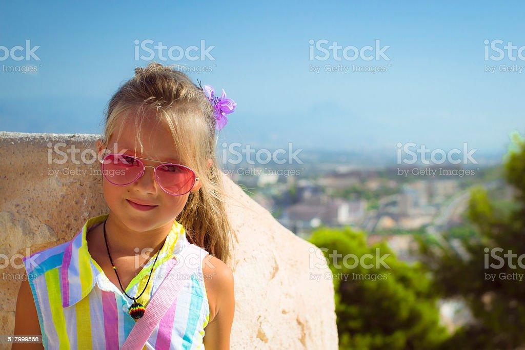 Girl in pink glasses, Alicante, Valencia, Spain stock photo