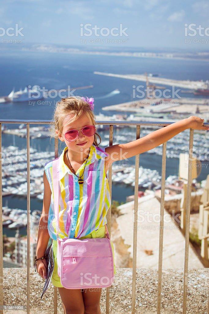Girl in pink glasses, castle Santa Barbara stock photo