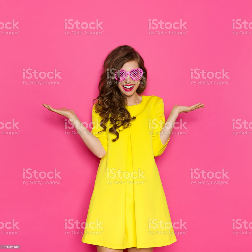 Girl In Pink Sunglasses With Hand Raised stock photo