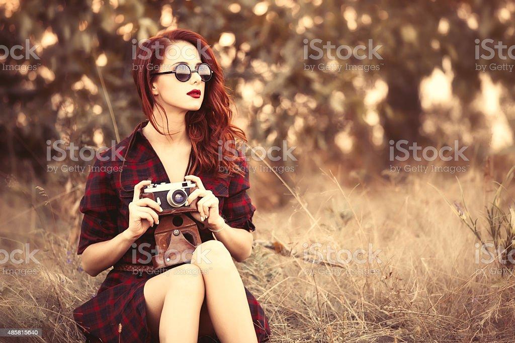 girl in plaid dress retro camera and sunglasses stock photo