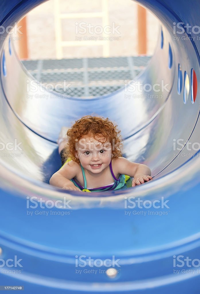 Girl in Playground Tunnel royalty-free stock photo