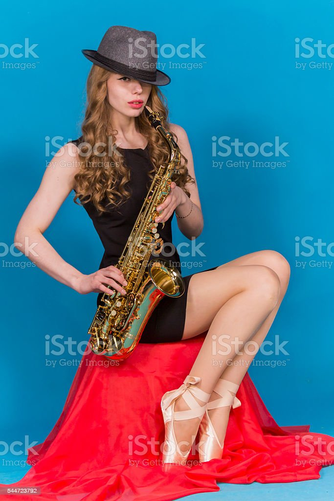 girl in Pointe and saxophone stock photo