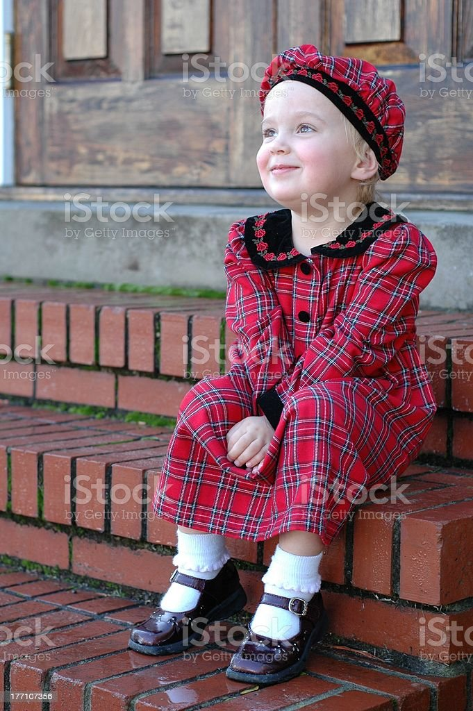 Girl in red plaid dress stock photo