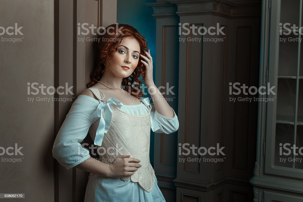 Girl in retro dress flirts looks. stock photo