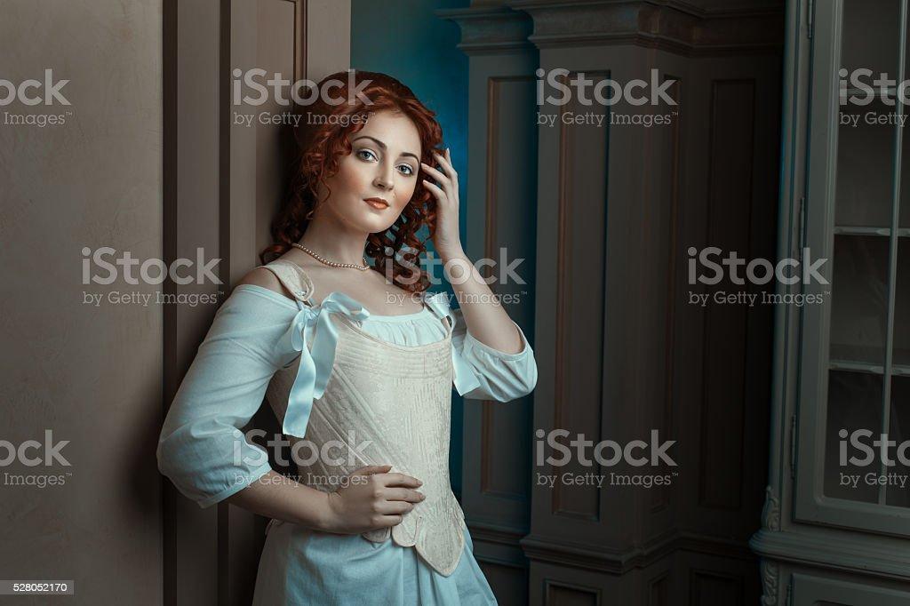 Girl in retro dress flirts looks. stock photo