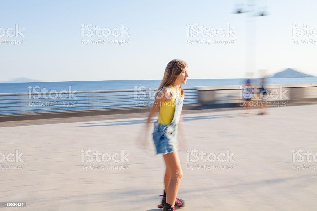 Girl in Roller Skates stock photo