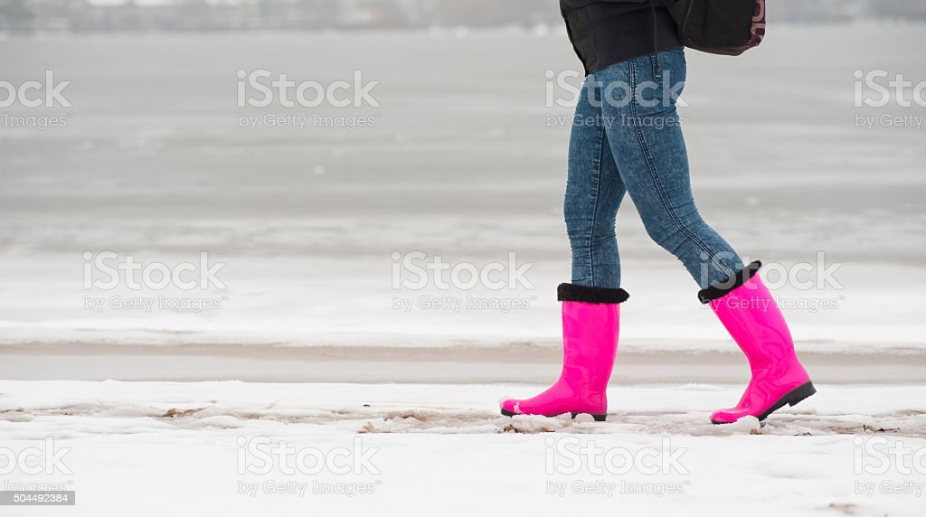 girl in rubber boots stock photo