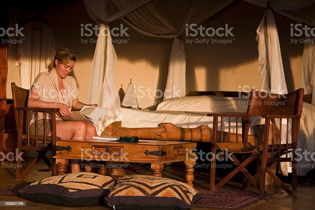 Girl in safari bedroom stock photo