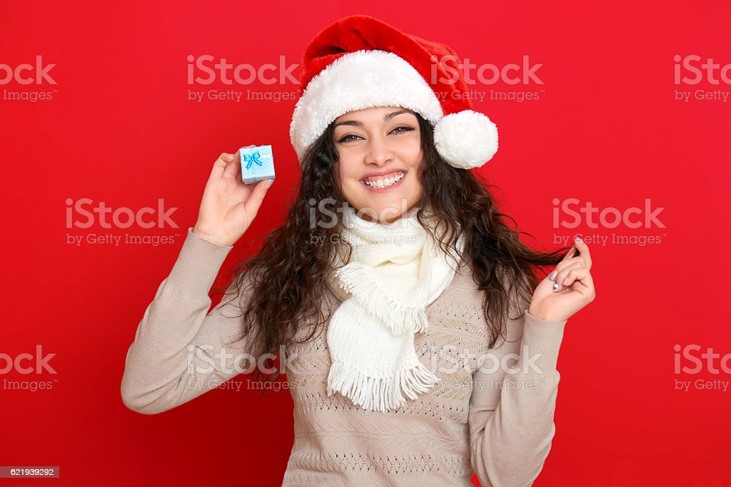 girl in santa hat portrait on red background stock photo
