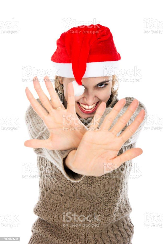 Girl in Santa hat showing hands stop stock photo