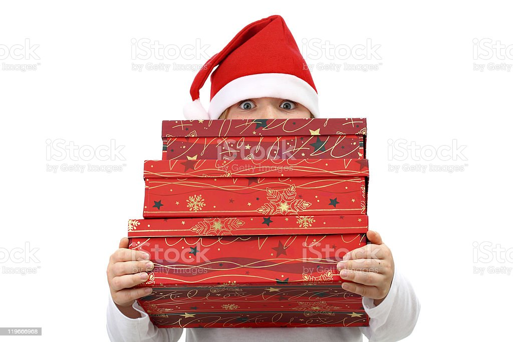 Girl in Santa's hat carrying three presents isolated on white royalty-free stock photo
