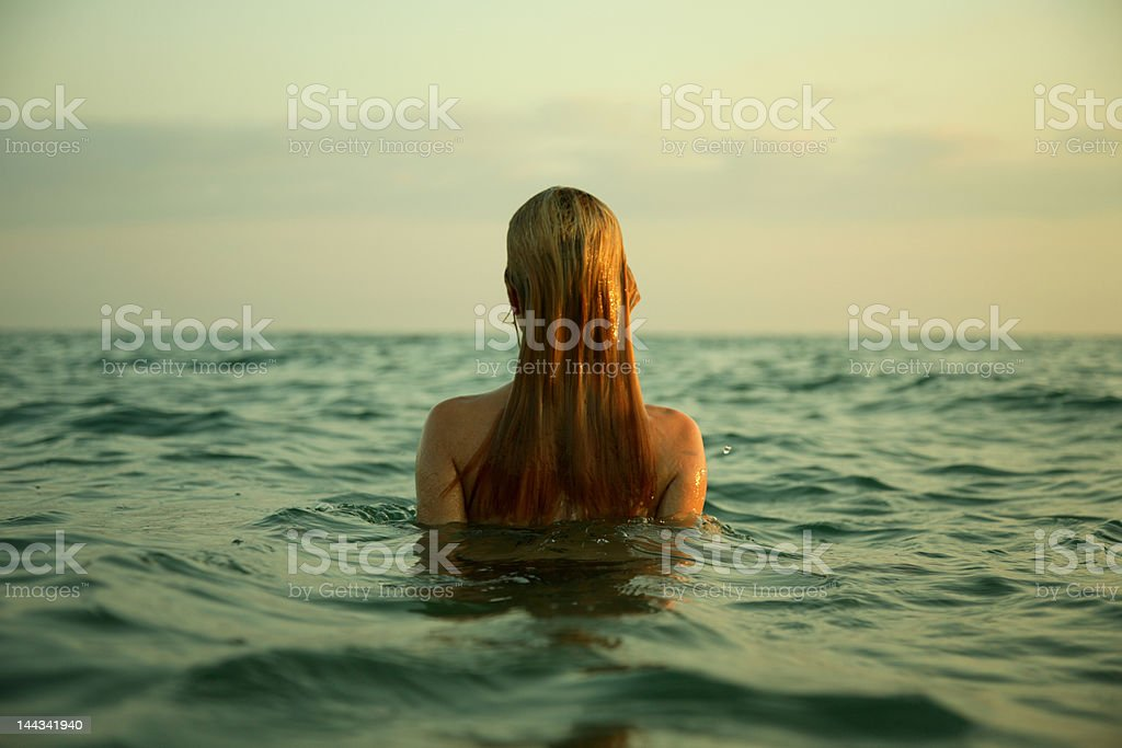 girl in sea waves royalty-free stock photo